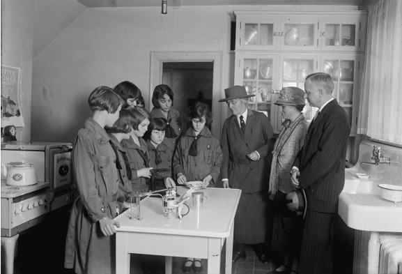 Lou Henry Hoover (third from right) supervises a kitchen demonstration at the Little House (Harris & Ewing Collection, Library of Congress)