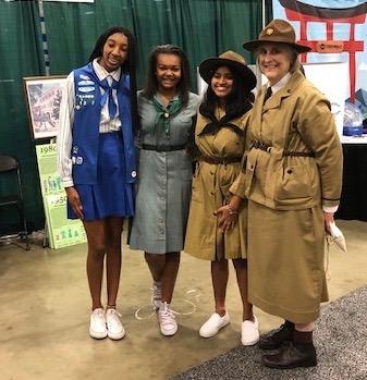 Models at a vintage Girl Scout uniform fashion show
