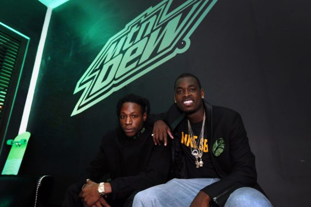 Hip Hop artist Joey Bada$$, left, and pro skateboarder Theotis Beasley have a damn good time, with a touch of class, at an event for MTN DEW BLACK LABEL at Parlor, on Thursday, April 14, 2016 in New York. MTN DEW BLACK LABEL is A DEEPER DARKER DEW that's now available nationwide. (Jason DeCrow/AP Images for MTN DEW BLACK LABEL)