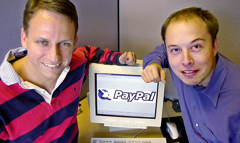 PayPal Chief Executive Officer Peter Thiel, left, and founder Elon Musk, right, pose with the PayPal logo at corporate headquarters in Palo Alto, Calif., Oct. 20, 2000. Online payment provider PayPal Inc. raised $70.2 million in its widely anticipated initial public offering, but a patent infringement lawsuit gave investors reason to be wary as the stock began trading Friday, Feb. 15, 2002 on the Nasdaq Stock Market. After covering expenses, Palo Alto-based PayPal expects to net $61.3 million from the initial sale Thursday of 5.4 million shares at $13 apiece, according to a Securities and Exchange Commission filing. (AP Photo/Paul Sakuma, File)