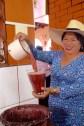Saida del Caucau II serving Chicha de Arequipa