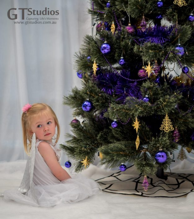 Pretty girl and Christmas tree