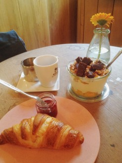 9. Breakfast at Yoghurt Barn: coffee, a toasted croissant, and brownie-and-peach yoghurt mix.
