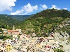 17. We travelled next to the town of Vernazza, where we scaled the remains of the medieval Castello Doria for a bird's eye view. There are two clock towers, many restaurants and shops along the main street, and the town is known for its beach area, which draws swimmers, sunbathers, and anyone who wants to catch some sun.