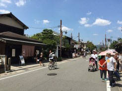 """22. On the """"Randen"""" train on the Keifuku Electric Railroad, we got to Arashiyama, a district to the west of Kyoto known for a number of religious and natural tourist sites. We later took the same train to the Kitano-Hakubaichō station to visit the Kinkakuji Temple, or the Golden Pavilion."""