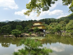 25. Housed within a garden, the Kinkakuji Temple is a Buddhist hall, and its upper two levels are covered with gold foil on lacquer. Visitors do not enter the hall, but follow a marked path to view the surrounding buildings and structures.