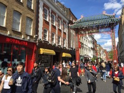 15. Chinatown in London bustles with activity, and is marked by a few gates across the streets.