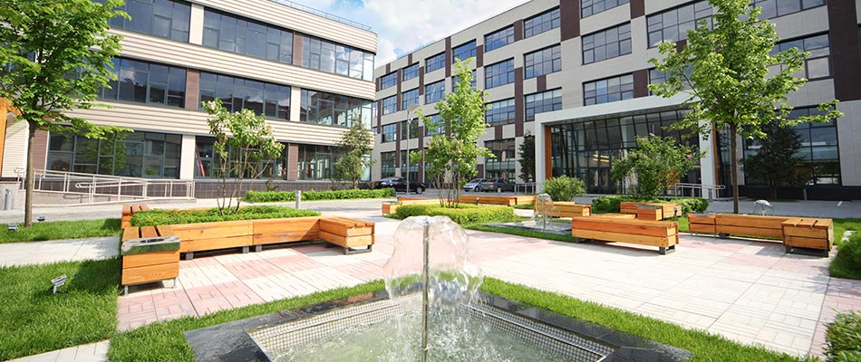 Building with trees and water fountain