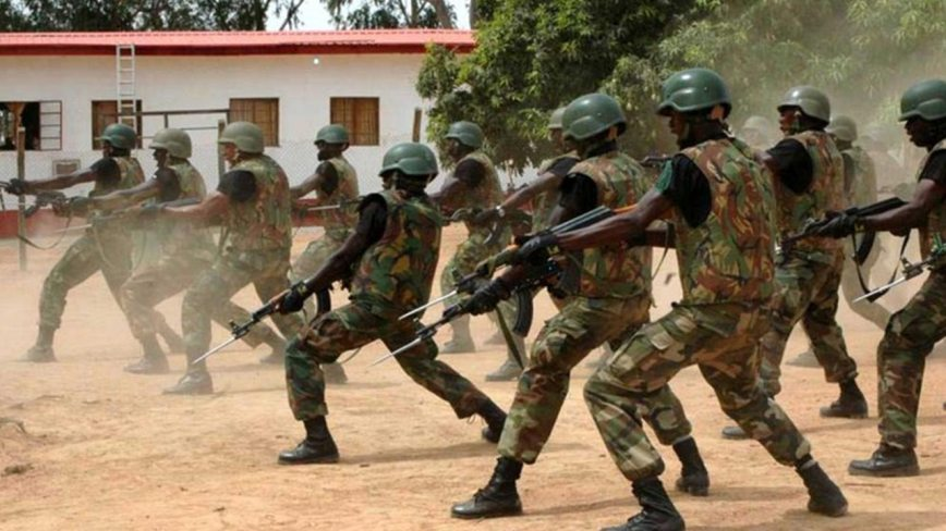 Image result for Buhari and Nigerian army battalion