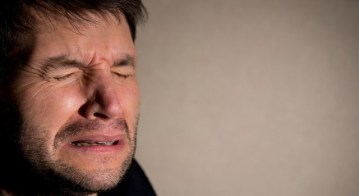 Man crying alone