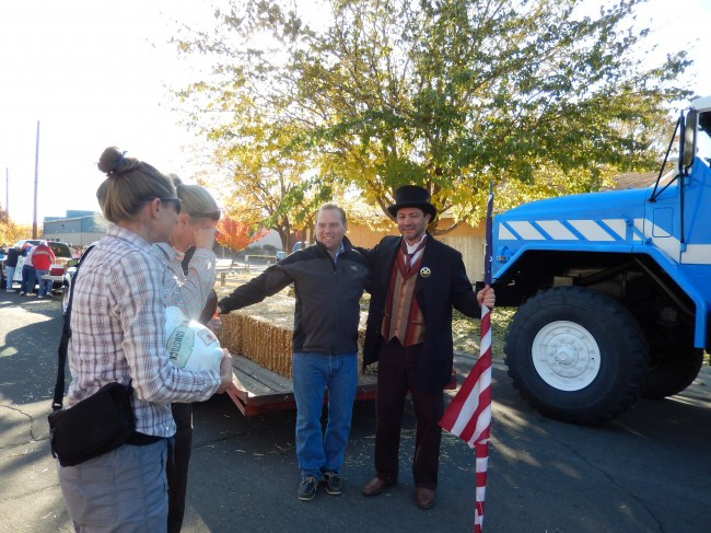 Dave Thomas, Director of Mining and Processing, and Corrado DeGasperis, CEO and President, pal around before the 75th annual Nevada Day Parade as Kiersten Briggs, and Lindsey Dugas look on