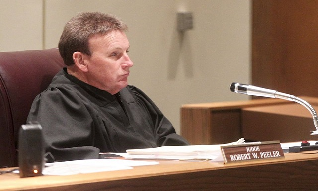 Judge Robert Warren Seeks to Fight Heroin Needles With Treatment Needles