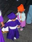 little boy in cucuruchas dress