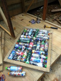 a ready door: frame, chicken wire and bottles