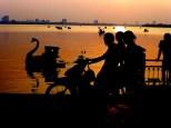 family enjoying sunset at the West Lake