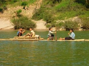 brushing teeth on a bamboo raft