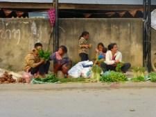 family selling vegetables at the market in Phongsavan