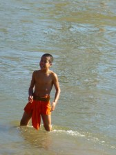 young monk having fun in the Mekong