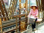 bicycling over Long Bien bridge