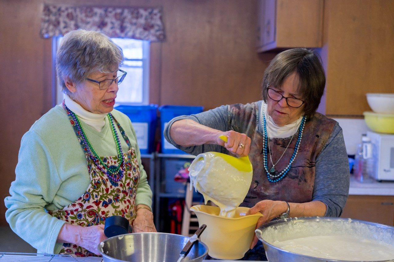 Nancy and Judy portioning the batter