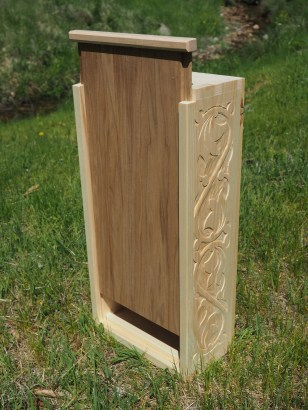 Pine tool box with butternut sliding lid and low-relief carving.