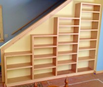 Bookshelves efficiently and completely fill an otherwise wasted space.