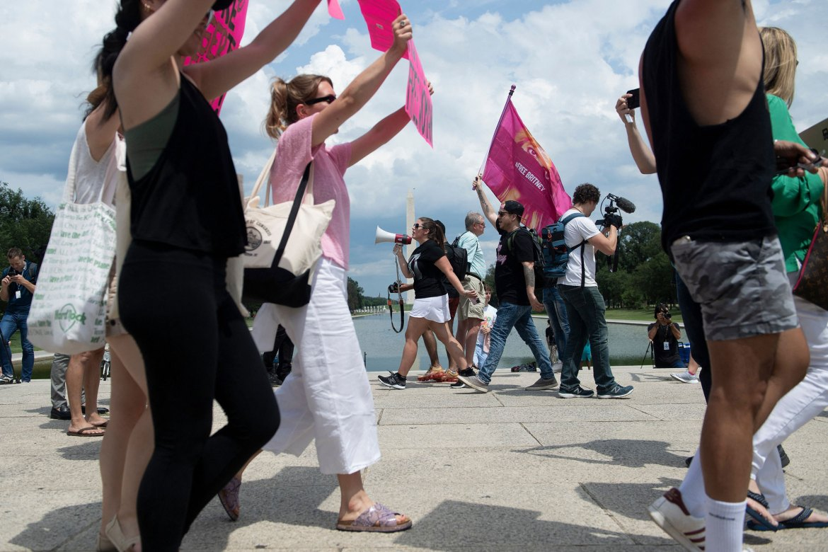 People demonstrate against Britney Spears Conservatories in front of the Lincoln Memorial in Washington, DC on Wednesday, July 14th.