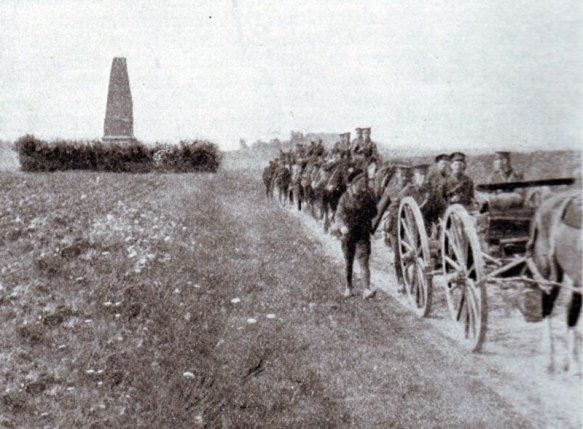 British transport passing the Malplaquet memorial to the south of Mons during the retreat