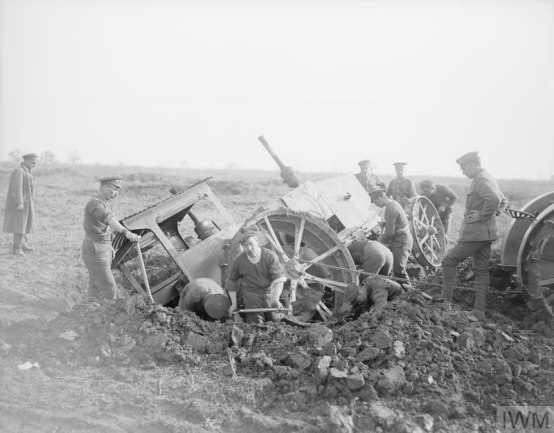An agricultural tractor stuck in a shell-hole at the Agricultural Directorate farm, Roye, 9 March 1918.