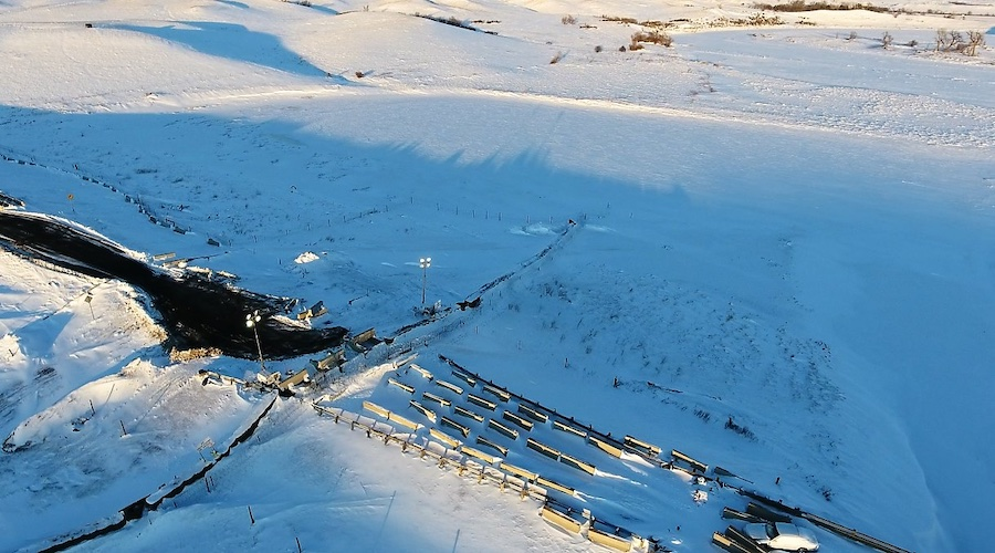 Standing Rock - Aerial view of snow covered highway 1806