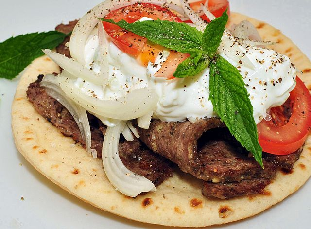 A gyro is made from lamb in a pita with tzatziki sauce.
