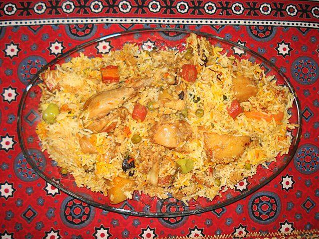 Sindhi Biryani is a dish with meat (or fish/shrimp), basmati rice, potatoes, tomatoes, yogurt, chili powder, and other ingredients.