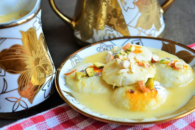 Ras malai is a dessert made from cheese curds soaked in clotted cream and turned into a dough.