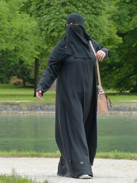 Woman wearing an abaya and niqab.