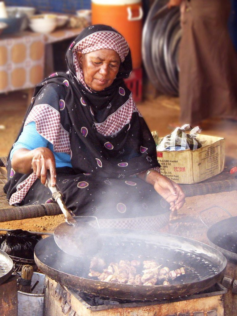A woman cooking in Sudan
