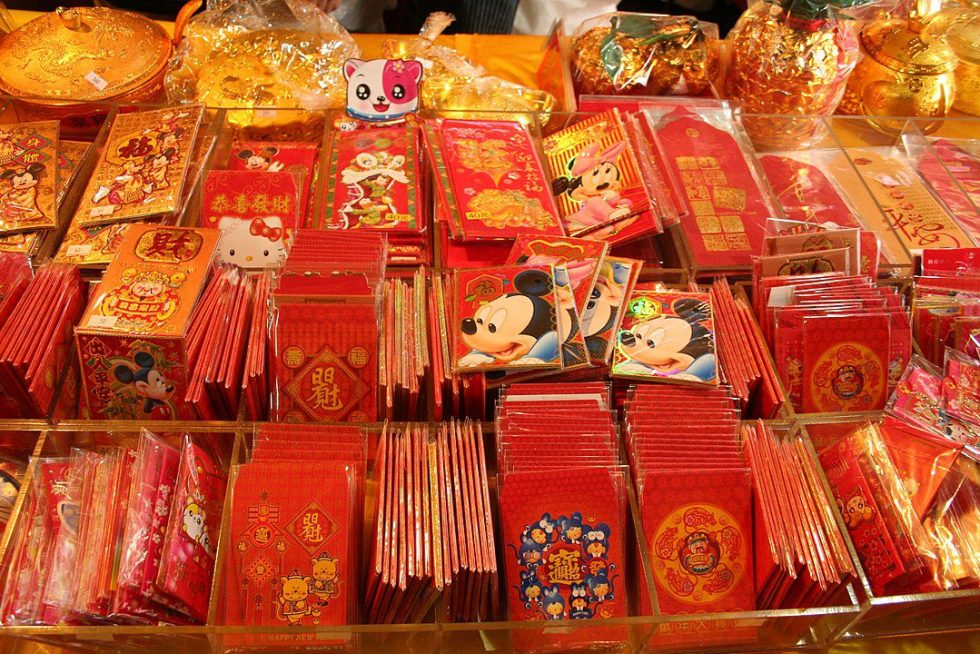 Red envelopes are passed out during Chinese New Year's celebrations. The envelopes or packets almost always contain money.