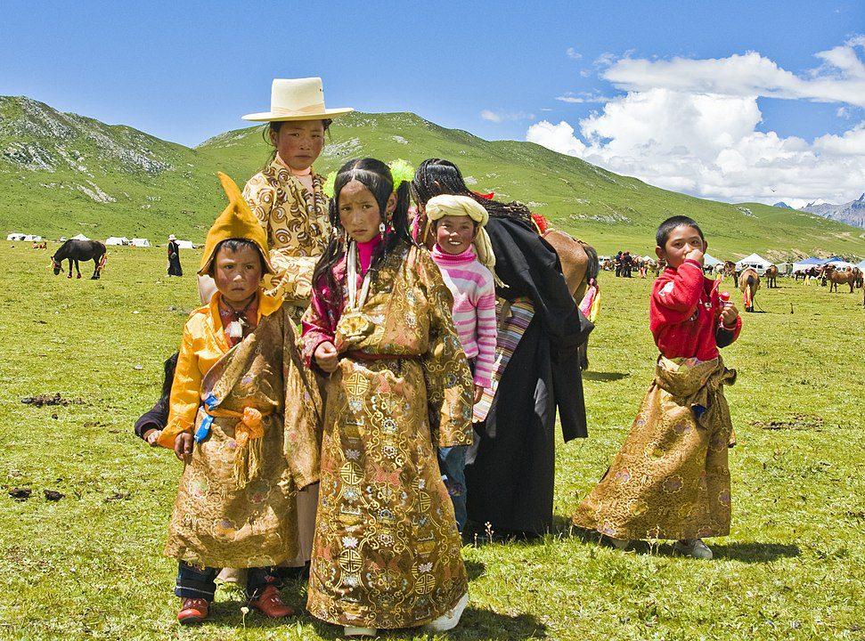 Tibetan family in Kham attending a horse festival