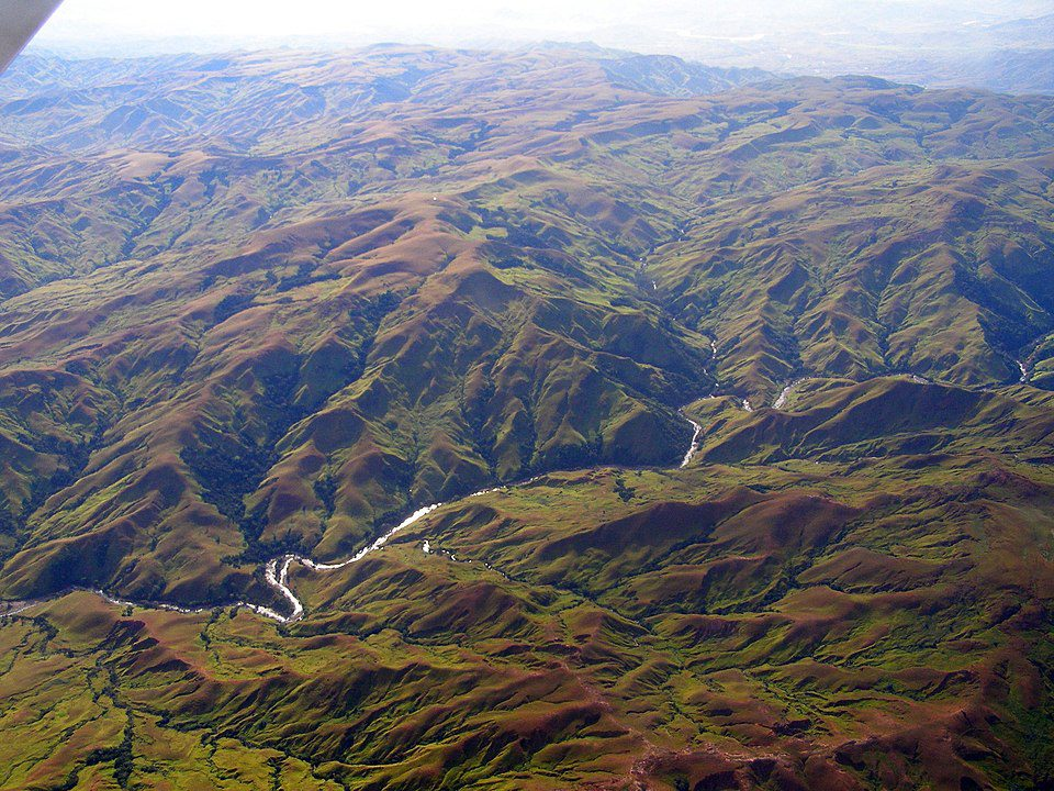 Aerial photograph of the Madagascar Central Highland Plateau, where deforestation has led to extensive siltation and the unstable flows of western rivers.