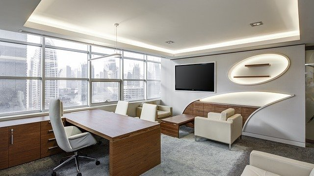 A modern office with light wood and white-colored furniture