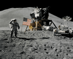 Astronaut James Irwin gives salute beside U.S. flag during EVA