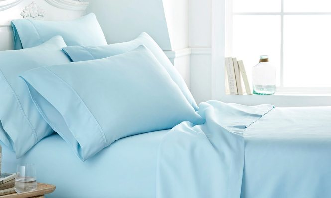 Bright Bedroom With Light Blue Deep Pocket Sheets On Bed