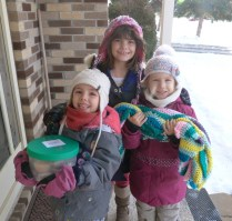 Girls preparing to give basket and blanket