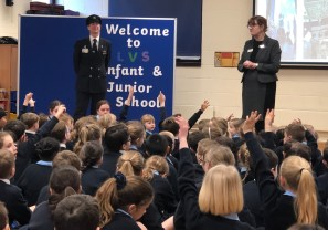 22.02.19. Pilot and parent Paul Jenner and Head of Infant & Junior School Rachael Cox ask if any pupils want to be pilots when they are older