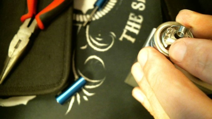 How To Rebuild The TFV4 Atomizer insert coil into deck 3