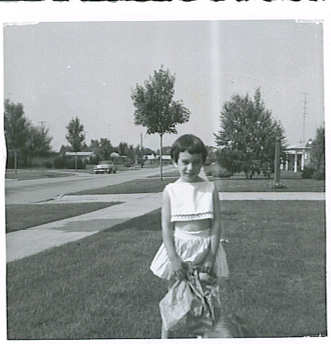 Nancy at 5, we tried to get a photo of Aunt Ida holding baby Nancy... but this is adorable too!