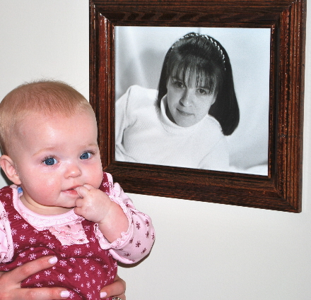 Looking at my Mommy's photo in Poppy's office.... She is soooo little!   Daddy loves her bangs!