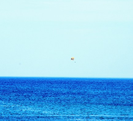 A person parasailing out over the bay!