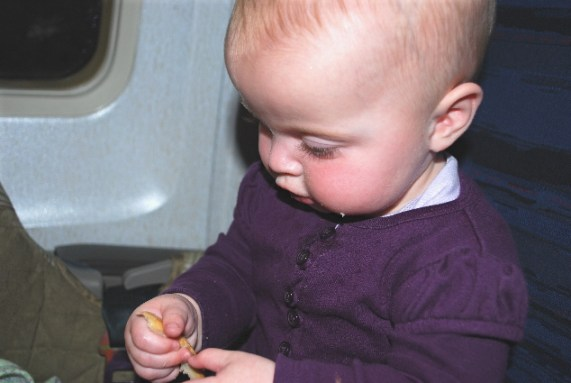 Here I am on the plane.... nibbling on crust some more!