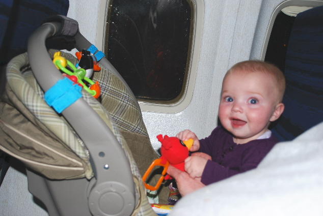 I am having a blast, my own big girl seat... toys and BREAD CRUST !