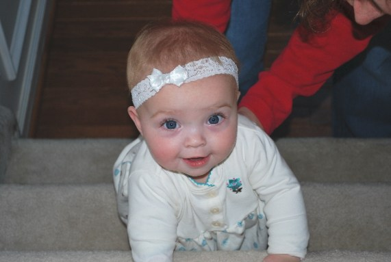 Nana says no playing on stairs, but if one of my aunts helps me, I at least ATTEMPT to crawl...